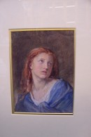 Girl with red hair and blue cloak