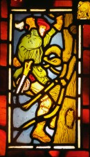 Stained glass panel of a woodcutter