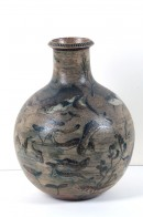 Vase decorated with an incised pattern of fish and sea plants