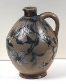 Jug is etched in a decorative floral pattern