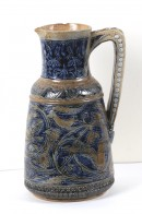 Jug decorated in a pattern of flowers and squirrels in blue and fawn