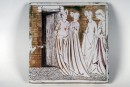 Tile with group of four women standing in front of open door.