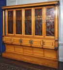 Large wooden cabinet with painted doors