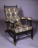 mahogany adjustable back armchair upholstered in daffodil chintz