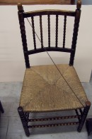 G47 Rush-seated ebonised wood chair