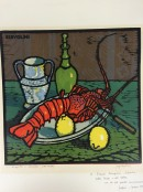 crayfish on a plate with lemons, bottle and glass on table