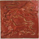 Red lustre tile with two lions