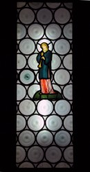 stained glass panel showing minstrel