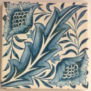 tile, hand painted with design of a leaf with two flowers