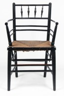 G55 Rush-seated ebonised 'Sussex' armchair