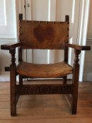 Large wooden armchair with leather seat
