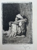 cloaked figure seated in doorway