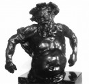 Half-length figure of a bearded and laughing man, nude except for drapery over left upper arm, falling across back, the arms held slightly out from the body with the hands turned backwards, the figure on a dark veined marble base.