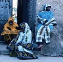 Four women wearing kanga in Tanzania