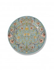 Circular plate with a floral pattern against a light blue background.
