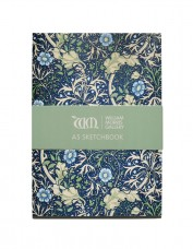 Photo of sketchbook decorated with dark blue Morris pattern