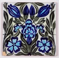tile with blue flowers and green foliage