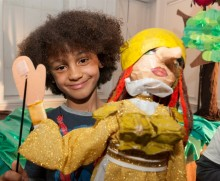 Boy playing with a puppet for homepage thumbnail