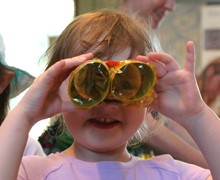 Girl with binoculars for home page