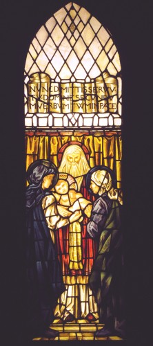 Stained glass panel of a High Priest holding Jesus, with Mary and another woman
