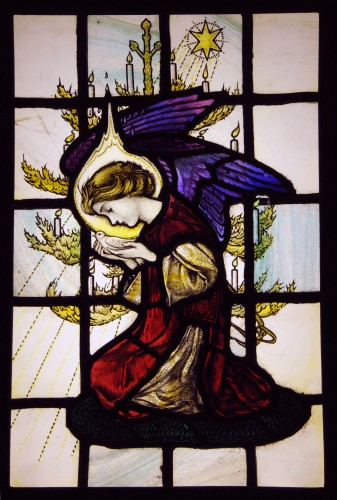 Stained glass panel of an angel kneeling