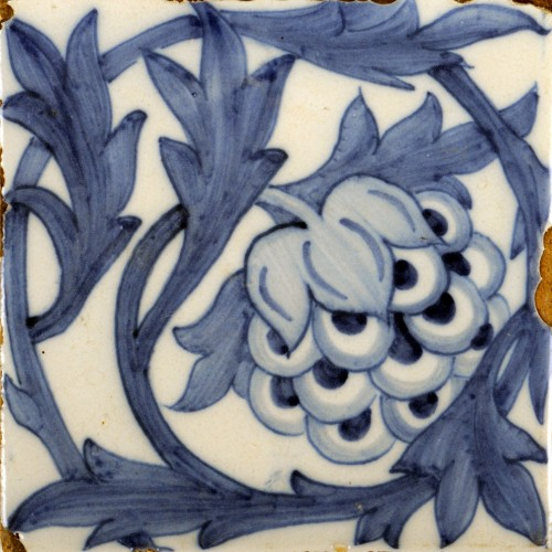white square tile depicting blue artichoke