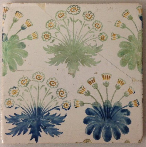 tile, hand painted with clumps of daisies