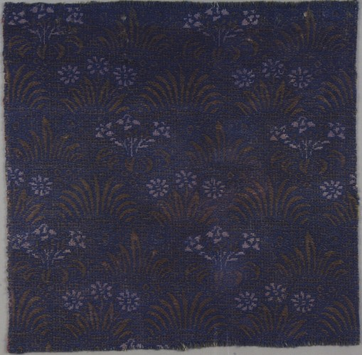 Fragment of blue carpet with daisy pattern