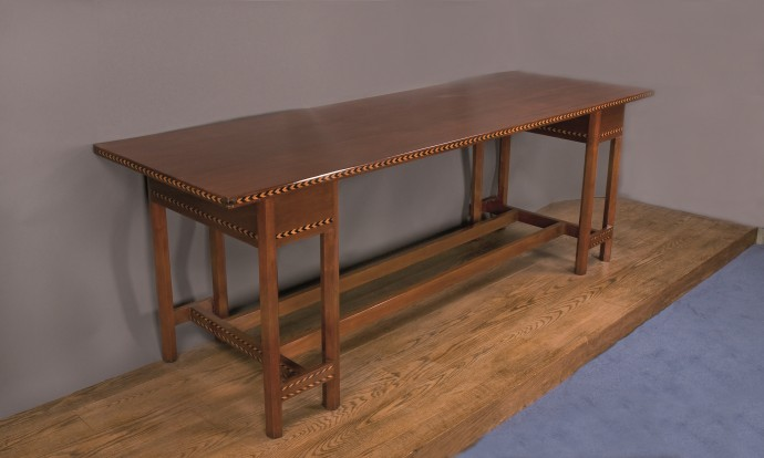 Mahogony table decorated with inlaid chevrons