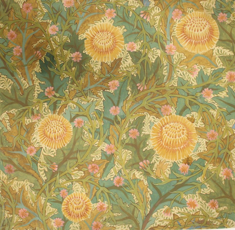 A busy floral pattern in greens and yellows