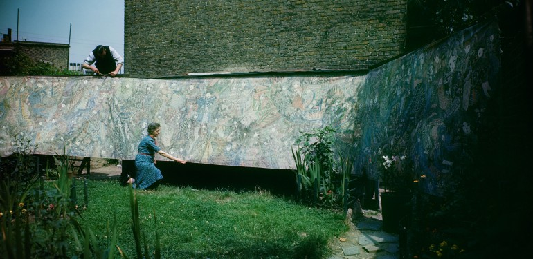 Madge Gill displays her work, Plashet Grove, East Ham, London, 1947
